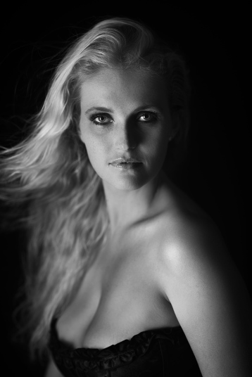Renate with a single strip light on a black background.